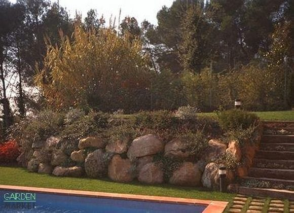 C mo hacer una solera que rellene un muro de piedra - Suelo jardin barato ...